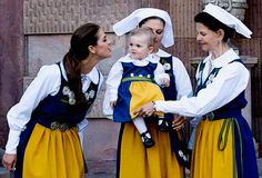 Princess Madeleine, Crown Princess Victoria holding Princess Estelle and Queens Silvia of Sweden