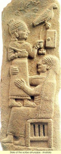 8th century BC city of Gurgum was the capital of a neo-Hittite kingdom in southeast Anatolia, and a center for the production of stelae with Hittite hieroglyphs. Depicted is the young Tarhunpiyas standing on his mother's knees, holding a stylus and the leash to his hawk. A writing tablet is placed before him, above his mother's head.