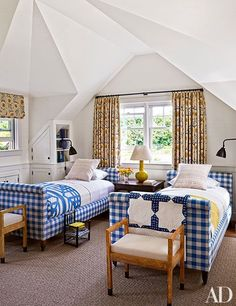 A guest room at the Martha's Vineyard summer home of Lynn Forester de Rothschild and her husband, Sir Evelyn, is outfitted with twin beds designed by Mark Cunningham; the curtains are of a Robert Kime fabric from John Rosselli & Assoc. and were made by Anthony Lawrence-Belfair.