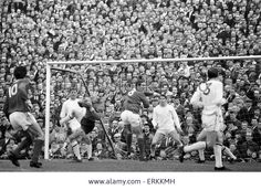 22nd April 1967. Nottingham Forest goalkeeper Peter Grummitt foils Arsenal striker John Radford. His fellow defenders are, from the left, Bobby McKinlay, Peter Hindley and John Winfield.