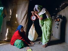 Jamkhed, India -- Comprehensive Rural Health Project  (This is is how the village health workers weigh the babies).