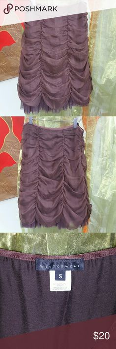 """Weston Wear skirt Very unique Anthro skirt that makes me think of grabbing a whiskey on the set of Gunsmoke with Miss Kitty!  Great with cowboy boots or flip-flops...both go with everything! There are layers of tulle with a sheer, draped overlay.  Size small.  27"""" waist w/ a thin slightly stretchy waist band.  22 1/2"""" long with side zip. I am a curvy 6 and it hugs the curves!  The last pic just shows multiple layers.  No damage and from smoke free home weston wear Skirts A-Line or Full"""
