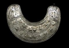 Urartian Silver Pectoral, c. 7th Century BC The pectoral is decorated with sirens walking in profile, five in the upper register and seven in the lower, interspersed with palmettes (possibly representing a sacred tree), each frieze with a raised band...
