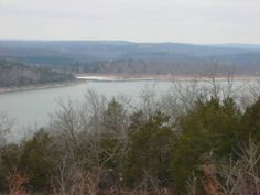 Enjoy the marina lights from this 2 acre home site in Mountain Home, AR.
