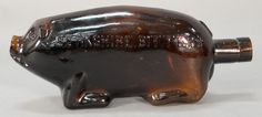 Berkshire Bitters deep amber pig bottle by Amann and Co., Cincinnati O, excellent condition.  ht. 4 in.; lg. 9 3/4 in. ~ Realized Price $ 2,250.00