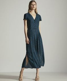 Long polka dot dress, 35.99€ - Long dress with short sleeves, V-neckline, button-up fastening and a belt that ties around the waist. Garment measurements: Total length from point of union between neckline and shoulder: 129cm. This measurement is calculated based on a size M. - Find more trends in women fashion at Oysho .