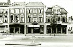 Ennam-garage aan de Hereweg met rechts de ingang van de J. A. Feithstraat, 1976