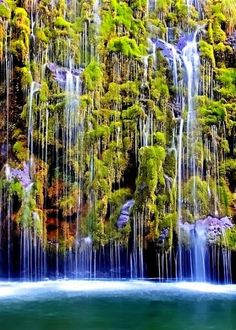 Mossbrae Falls is a waterfall flowing into the Sacramento River, in the Shasta Cascade area in Dunsmuir, California. Access to the falls is via a mile-long hiking trail on the Union Pacific Railroad tracks. Places To Travel, Places To See, Vacation Places, Vacations, Travel Destinations, Places Around The World, Around The Worlds, Beautiful World, Beautiful Places