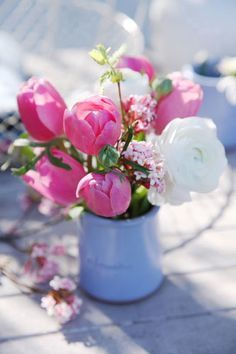 Spring Vase- I like how unfussy this is while also being very pretty. I'd replace the tulips with a different flower though.