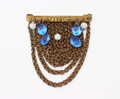 1930s Art Deco Brooch with Brass Chain and Blue Czech Glass  Available for purchase on Etsy: http://etsy.me/29Ou1y8