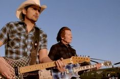Brad Paisley and John Fogerty Stick up for War Veterans in 'Love and War' Video