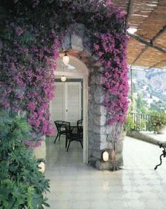 Love the Italian style!! Purple climbers on the patio perfect touch