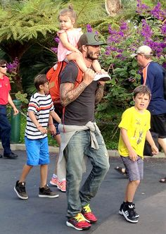 David Beckham (with daughter Harper on his shoulders) toured Legoland with his sons Romeo and Cruz!