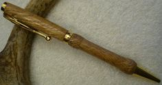 Hand turned pen, 101, White Oak with small knob and gold. $20.00, via Etsy.