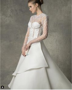 Venezulan wedding dress designer, Angel Sanchez, creates beautifully designed, structured wedding dresses.