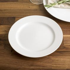 These simple white porcelain plates are perfect for any decor. Durable porcelain construction is dishwasher safe and great for everyday family meals or special occasions.