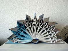 Have you seen all of the cool book art on Etsy?  Book Art Sculpture Autumn leaf by abadova on Etsy