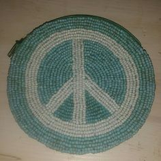 VINTAGE BEADED PEACE SIGN CHANGE PURSE Preowned very clean barely used beading peace sign on both sides.  No missing beads excellent condition  4 1/2inch round baby blue and white beads Accessories