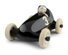 Playforever-The Bruno Racing Car is the car that started it all. Made with the best materials available, the Bruno Racing Car provides a smooth ride for children. Made from extremely durable plastic and designed to withstand play for years on end. Racing Car Design, Classic Series, Rubber Tires, Metallic Blue, Designer Toys, Home Living, Wood Toys, Desk Accessories, Courses