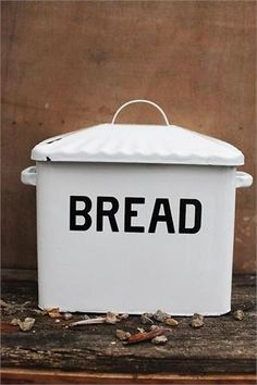 Our Vintage Style Enamel Bread Box is reminiscent of those found in old farmhouse kitchens. Features slightly distressed white enamelware finish with black text.