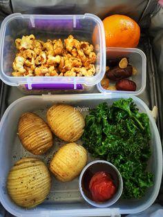 #lunchbox Mini hasselback potatoes, sautéed curly kale, BBQ &a tomato sauce, caramel popcorn, mandarin, dates, raisins