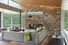 A Stone Wall Fireplace Adds An Outdoor Feel To The Light Filled Living Room.