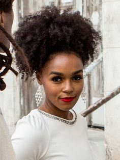 Janelle Monae's high ponytail at Solange Knowles's wedding in 2014 | allure.com