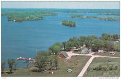 Vintage postcard:  Aerial view of Theona Lodge, Ennismore Ontario in Peterborough County.