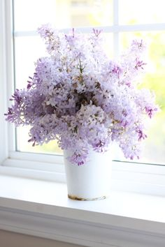 love lilacs - we had many tall bushes of them around the borders of my parents yard growing up - heavenly fragrance.