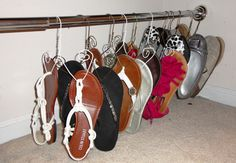Use metal coat hangers to organize shoes.  Use a shower curtain tension rod, and put it at the bottom of the closet.  Cut and twist coat hangers for the shoes.