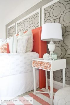 A really neat idea: framing sections of a wall with molding and using nailheads or wallpaper to create visual interest | Gray and Coral Bedroom Inspiration