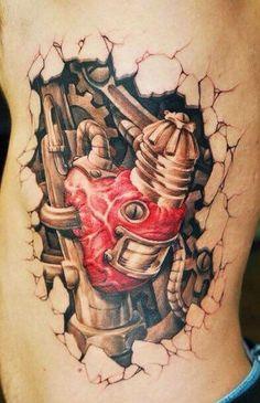 Bio mech heart tattoo