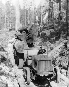 A loaded White logging truck  Early truck logging using a White truck on a wooden fore-an-aft road at Beaver Creek, Loughborough Inlet, BC.