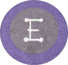 Round Gray rug with Purple border and White initial.