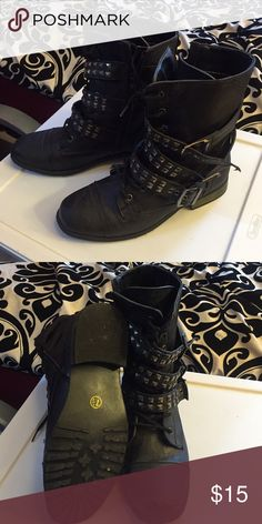 Black strappy studded combat boots Black leather combat boots. Lace up and side zipper. Straps with studs and buckles. Size 7 1/2. Only worn a couple times* Great condition! Shoes Combat & Moto Boots