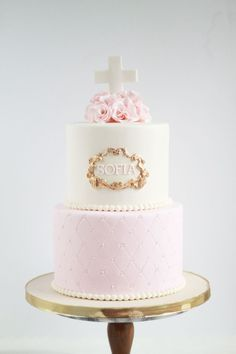 Soft pink, white and gold tiered baptism cake for a baby girl christening or first communion. Baby Girl Christening Cake, Girl Baptism Party, Baby Girl Cakes, Christening Party, Baptism Cakes For Girls, Baby Christening, First Communion Decorations, Girl Christening Decorations, First Holy Communion Cake
