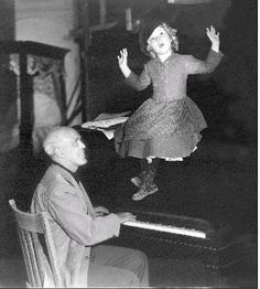 Shirley Temple rehearsing with songwriter Jimmy McHugh for Dimples, c.1936