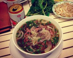 Pho Noodles!!! They can be found literally on every street corner in Saigon, and it will cost you anywhere from $1-3USD (depending on where you buy it).In short, Pho is a noodle dish that consists of rice noodles, herbs, meat and a mouth-watering broth.The meat is usually beef, but sometimes you can ask for chicken instead.  The Vietnamese herbs really give this dish a unique flavor and taste. It would be a crime to go to Vietnam and not eat Pho Noodles.  Eat them, and enjoy them, everyday!
