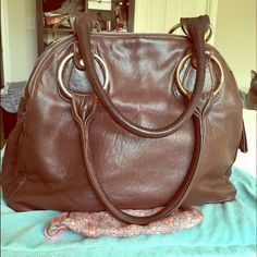 """Chocolate brown leather purse - made in USA Wonderfully soft large leather purse (17.5"""" width 13"""" height) with 3 large compartments, the middle compartment has a side pocket with a zipper, slotts for cards and pen holders. I used the purse daily for a long time and it has held up very well. Condition: Leather is super soft and in good condition but has a lil puncture marks (see 3rd pic) which are hardly noticeable, inside is pretty clean except towards the zipper area (see last pic), one…"""