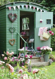 Garden Shed. Love the bunting, the heart wreaths and the colour! Everything!