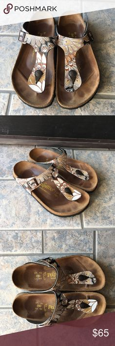 Papillio Gizeh by Birkenstock Sandals The color is in peacock brown. Preowned and in good condition. Fits a size 6 to 6.5 Birkenstock Shoes Sandals