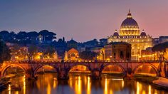 Ponte Sant'Angelo and St. Peter's Basilica in Rome, Italy -  © 4Corners