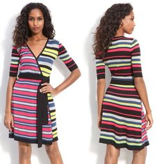 BCBG MaxAzria silk blend wrap dress This dress is gorgeous and vibrant! Bright Multi colored striped faux wrap dress by BCBG MaxAzria. 55%silk 45%cotton. Has a belt, 3/4 in sleeves. Excellent used condition. Size XS BCBGMaxAzria Dresses Mini