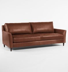 "$3999  Hastings Leather Sofa - | Rejuvenation - 86""W x 32-1/2""H x 36""D (NOTT deep enough but like the slim arm & ""tufted"" like single bench seat"
