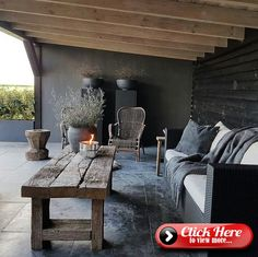 covered patio with dark slate flooring, reclaimed wood coffee table, black sofa . covered patio with dark slate flooring, reclaimed wood coffee table, black sofa with white cushions Back Patio, Backyard Patio, Rustic Patio, Reclaimed Wood Coffee Table, Slate Flooring, Black Sofa, White Cushions, Concrete Patio, Patio Stone