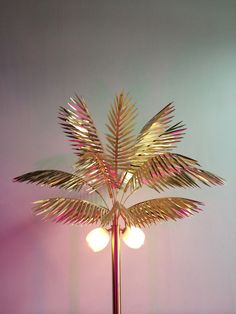 Tropical modernism having a moment with Syrette Lew of Moving Mountains' Palmyra lamp.