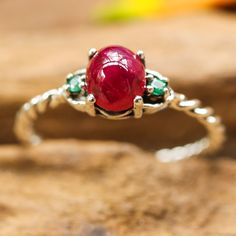 Pink Ruby ring with emerald gemstone side set gems in prongs setting with sterling silver twist band
