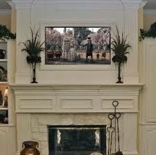 TV over fireplace with frame