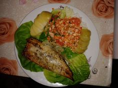 grilled fish with cheese,  boiled potatoes, celery, carrots and grapefruit salad with lemon based dressing