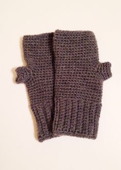 These warm Fingerless Mittens were crocheted using an acrylic yarn in charcoal grey. Measurements Cuff 3 inches long 3 3/4 inches wide  Mitten 5 1/4 inches long 3 3/4 inches wide Total 8 1/2 inches in length Will fit medium to large sized hands. Gentle handwash and lay flat to dry for best results and longer life. If you like these mittens but would like a different color or size, just send me a message and I'll work on a custom order just for you. :-)